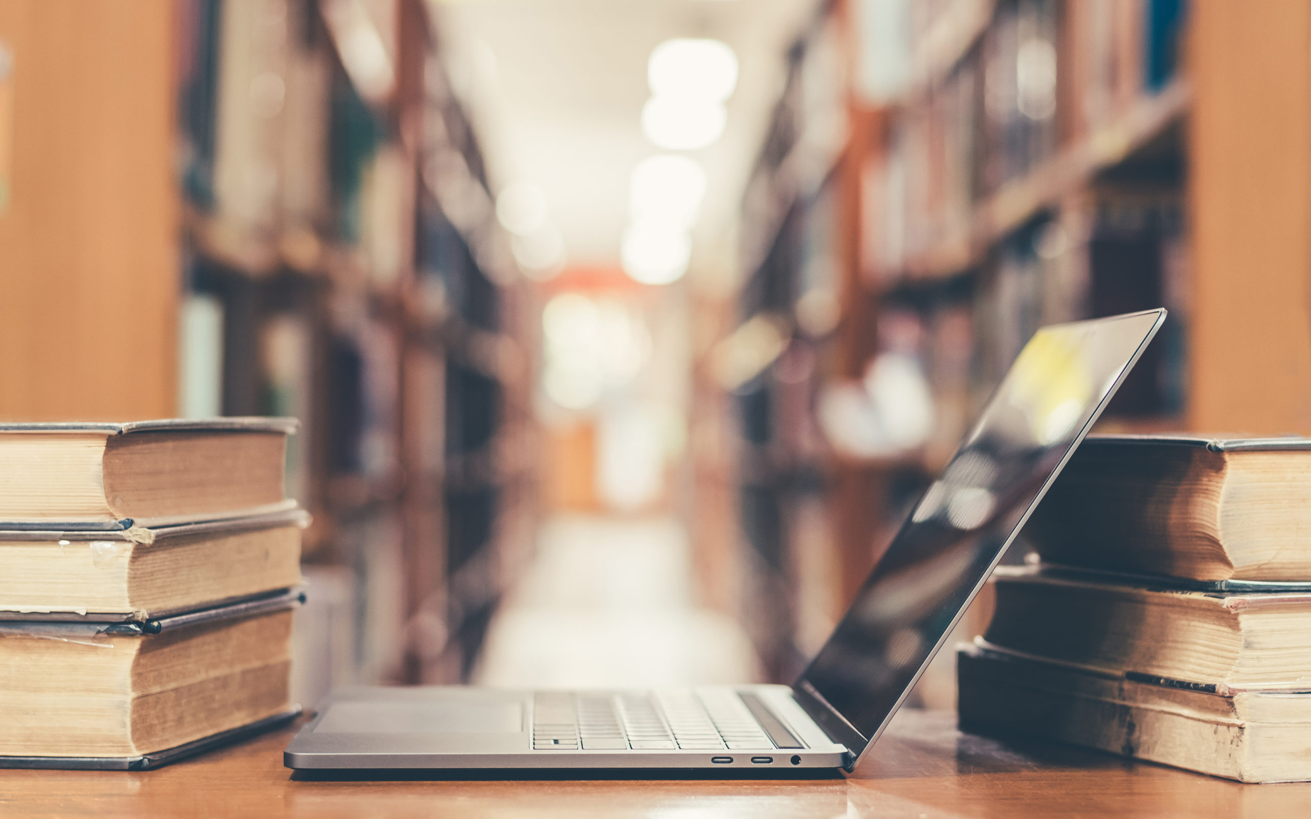 Laptop in library banner image